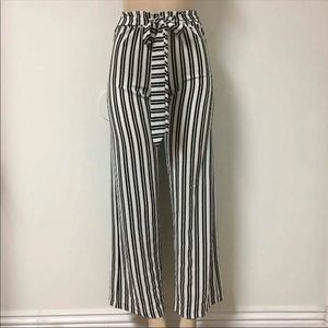 White on black waist tie trousers